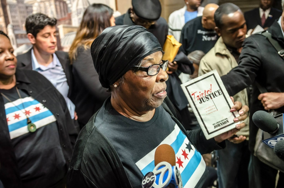 Mother of torture survivor Michael Johnson, Mary L. Johnson, speaks to the press after the City Council passes unprecedented reparations legislation. Photo: Sarah Jane Rhee