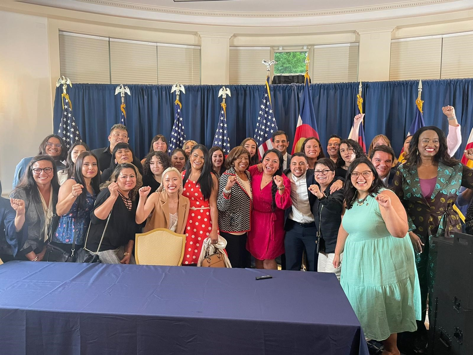 Immigrants and allies in Colorado celebrate the signing of a bill providing for a universal representation fund for immigrant legal defense.