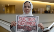 Dina with #SanctuaryEverywhere sign