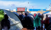 Migrants wait at the Chaparral Port of Entry, Tijuana