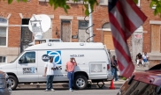 News van covering nonviolent civil actions in Baltimore