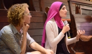 A woman speaks at the Countering Islamophobia town hall outside of the 2016 DNC