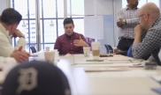 People talking at an office table