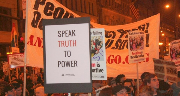 "sign that says ""Speak Truth to Power"""
