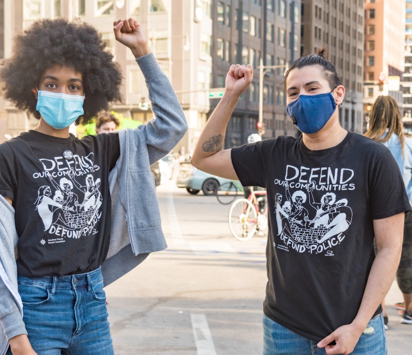 Two activists at a Defund Police protest