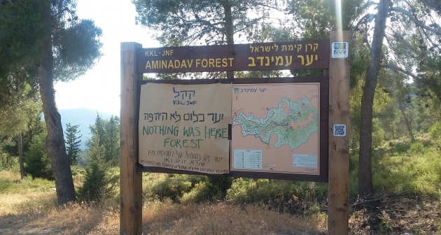 Satirical signs replacing JNF forest signs near Jerusalem as part of the international week of action