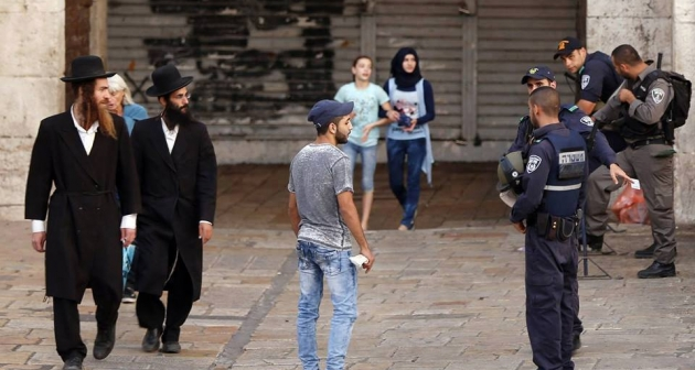 Young Palestinian asked to stand on the side for ID check and body search in front of Damascus Gate, Old City of Jerusalem