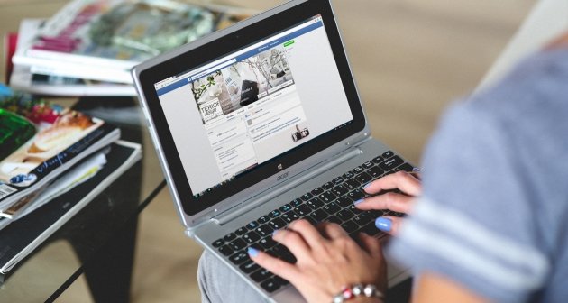 Woman types on laptop computer