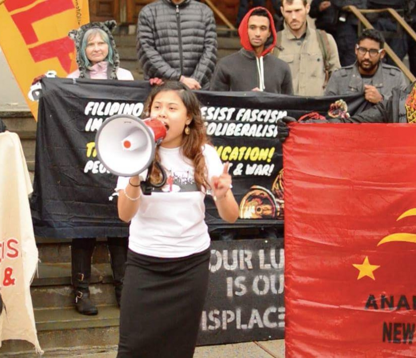 Joelle at a rally