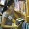 Volunteer at Pembroke arranging books in library.