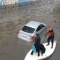 An emergency worker provides assistance to Gaza residents trapped by flooding.
