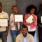 Youth from St Louis Peace Summit hold up certificates