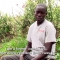 """Young man on camera with subtitles: """"I am a former combatant"""""""