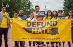 Campaigners holding up Defund Hate Banner in Washington D.C.