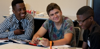 Young people sit and work together