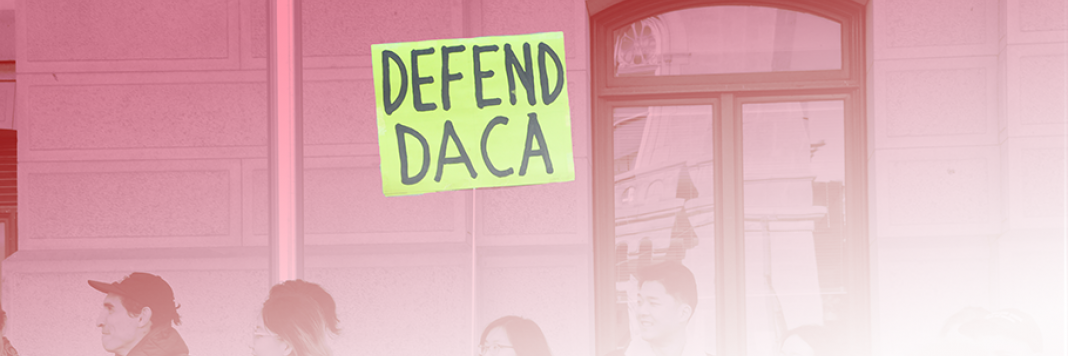 protest sign that reads defend daca
