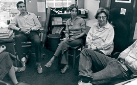 Five people meet in an office. black and white photo.