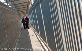 Two women talk with entering the checkpoint between Bethelehm and Jerusalem.