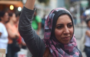 Palestinian woman raises hand over her head