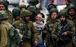 Palestinian child getting detained by the Israeli military