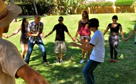 LA youth gardeners hold hands in a circle