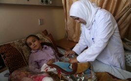 Child receiving medical aid in Gaza