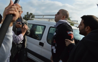 An activist is arrested by Israeli police.