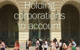 cover of magazine says holding corporations to account