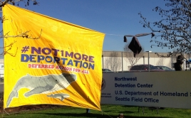 """A """"Not 1 More Deportation"""" sign hangs outside the Northwest Detention Center"""