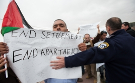 Palestinian activists demonstrating against the occupation