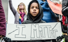 Young boy holds up I matter sign at protest