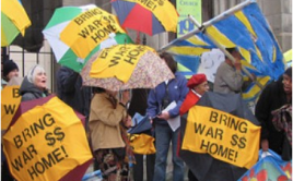 People holding umbrellas at budget protest