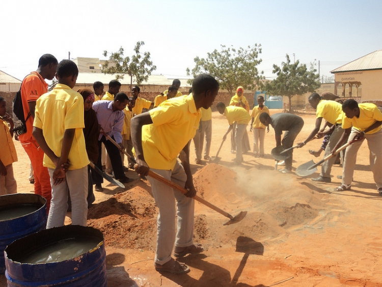 Young men work on a community improvement project