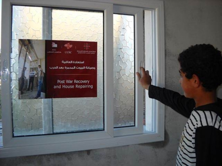 Sign in a window in a home in Gaza AFSC helped to repair in 2009