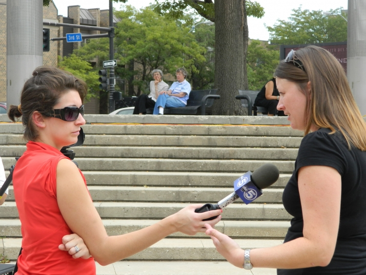 Jody Mashek (right), Legal Services Director for AFSC's Immigrants Voice Program in Des Moines, explains Deferred Action to a reporter from WOI TV.