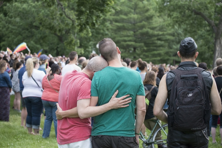 A couple at a vigil to unite in the wake of the Orlando Pulse shooting
