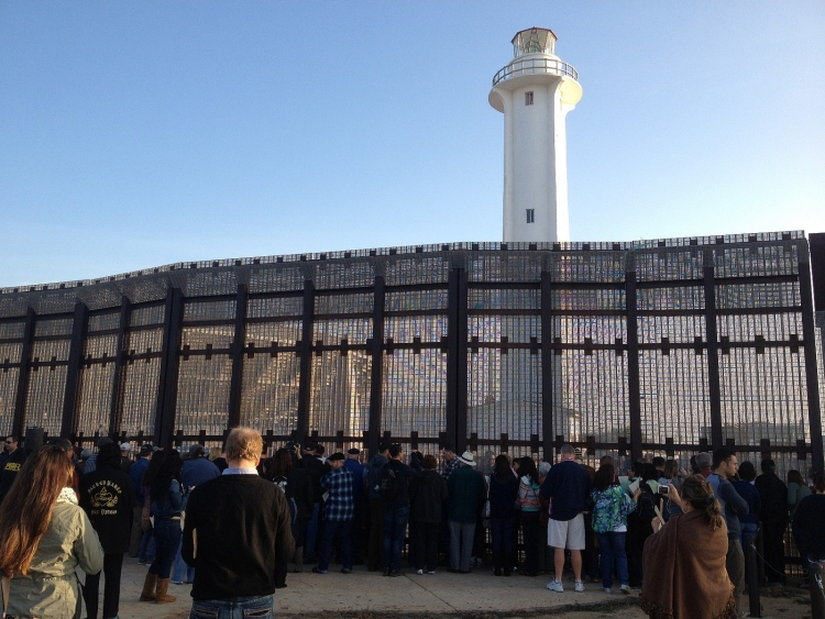 People gather by US/Mexico border