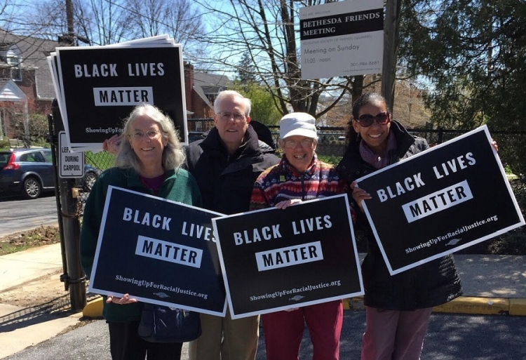 Lauren Brownlee, on right, and other members of Bethesda Friends Meeting preparing to hand out flyers supporting #BlackLivesMatter.