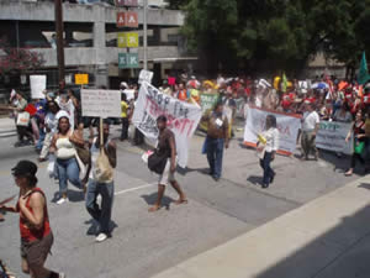 Community Social Advocates rally against negative immigration reform.