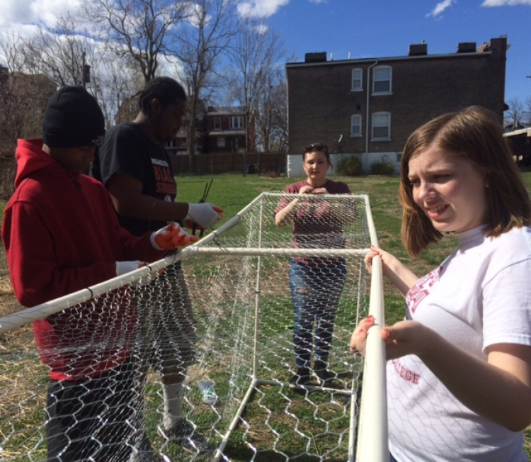 Earlham Spring Break in St. Louis 2016 building a moveable chicken coop