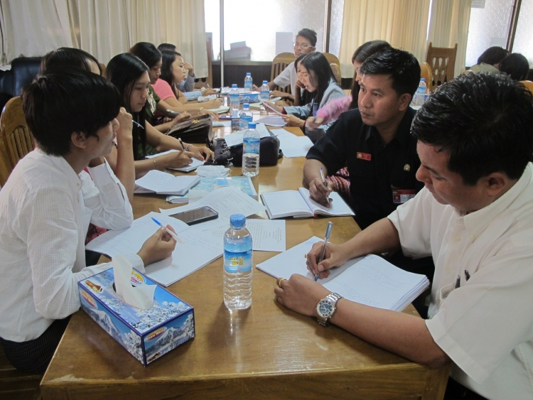 Training participants work together in Myanmar