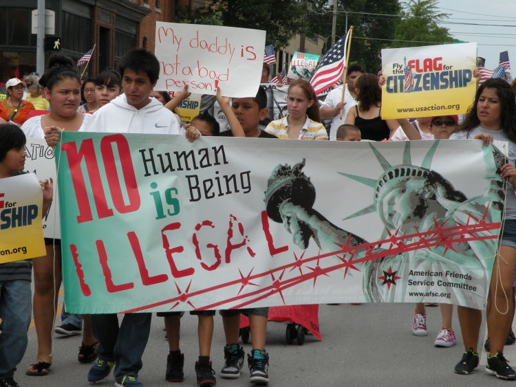 People with banner marching for immigrant rights
