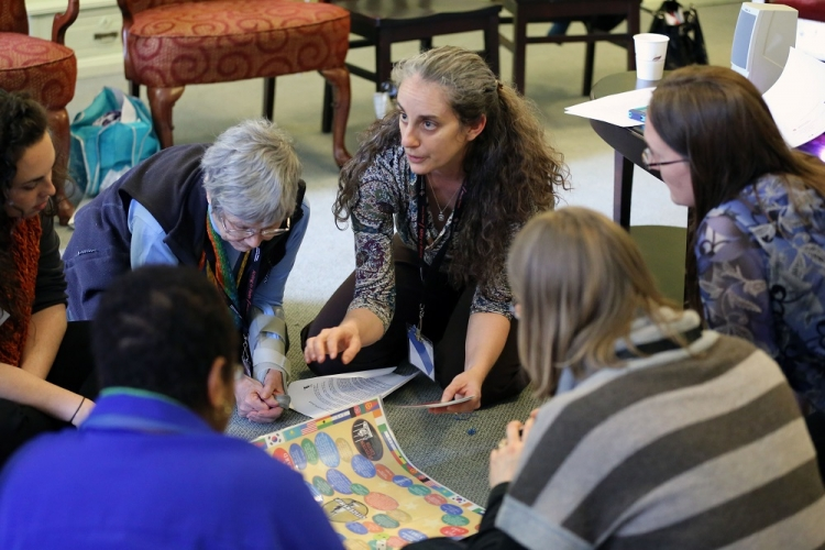 Jenn Piper leads members in an immigration game