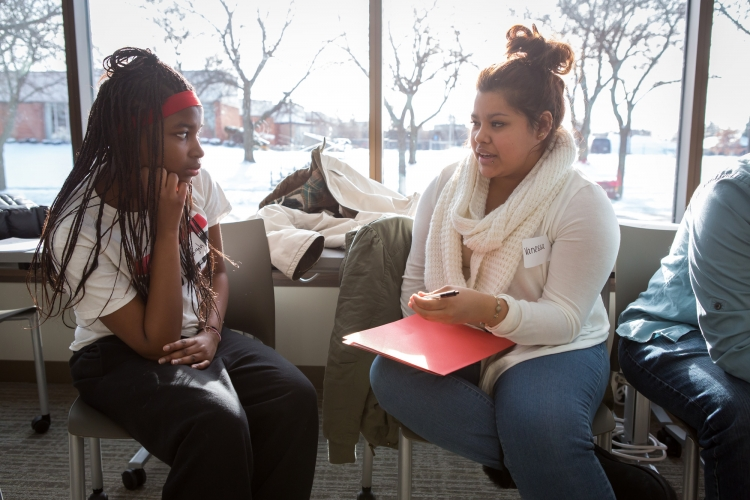 Two teens talking at a Freedom School.