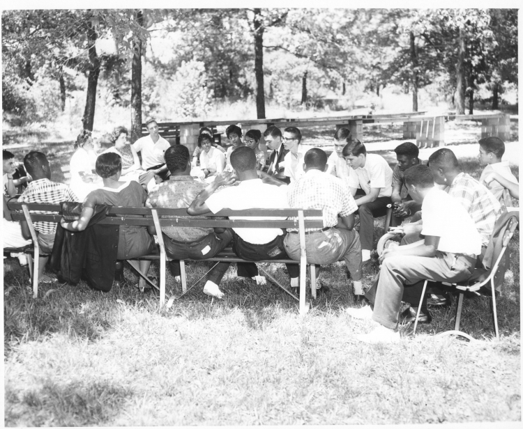 Participants hold an outdoor discussion at the Community Unity Conference