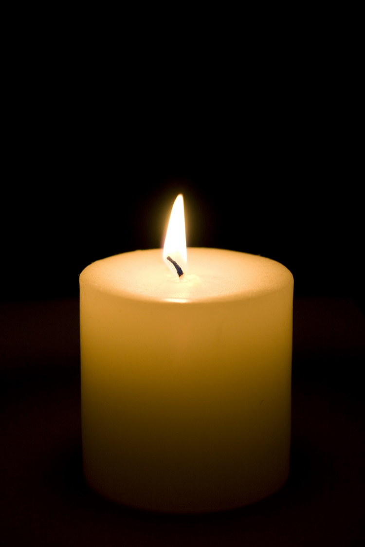 Simple candle by Adam Foster via Flickr CC