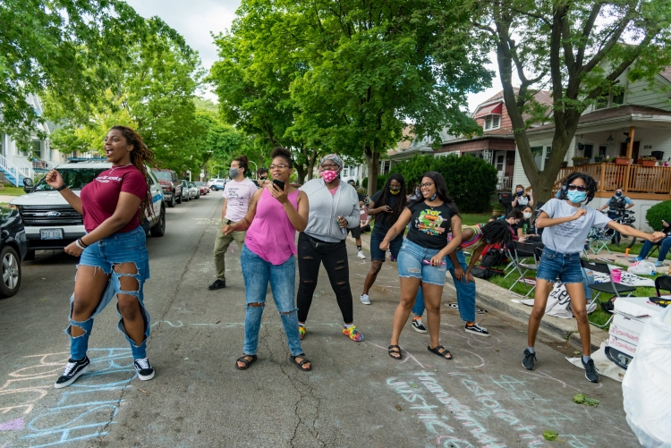 Young people dancing at a community organizing event