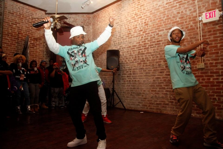 """Two men dancing to """"Stomp the Violence"""""""