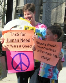 Volunteers in Kansas City protest during Tax Day.