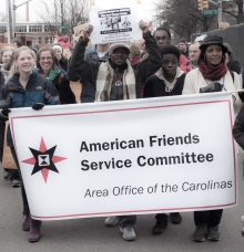 People marching with AFSC sign